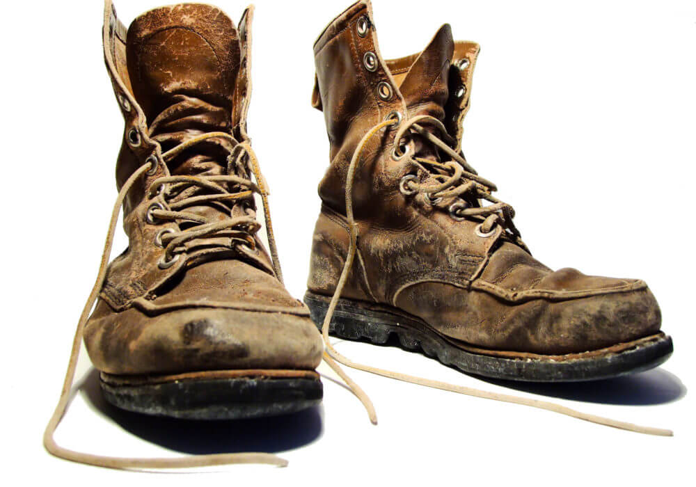 worn but durable work boots